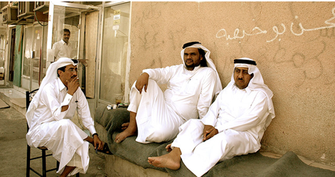 3 Qatari men relax in Doha